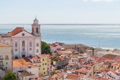 Cityview of Lisboa. Church, Buildings and Tejo river, Lisboa, Portugal Royalty Free Stock Photos