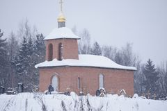 Church, built on the funds collected by the population, in winter near the estate Serednikovo. Orthodox brick Church on a churchyard of the Moscow region Royalty Free Stock Photo