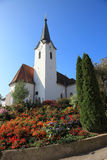 Church built on a hill and surrounded by flowers Royalty Free Stock Images