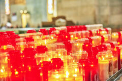 Church burning candles in glass candlesticks. Stock Image