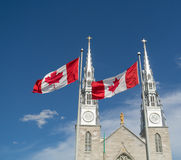 Church and Canada Flags. Flags in front of the Notre Dame Catholic Church in downtown Ottawa, Ontario,Canada Stock Photography