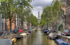 Church and canal in Amsterdam Stock Image