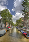 Church and canal in Amsterdam Royalty Free Stock Photography