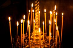 Church candelabrum with burning candles. Prayer and Meditation. Church candelabrum with burning candles. Religious solemn Christian holiday of Easter. The Royalty Free Stock Photo