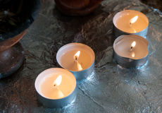 Church candle buring in oil Stock Photo