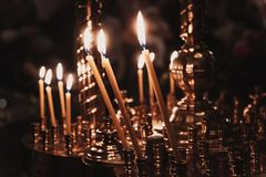 Church candle flame Stock Images
