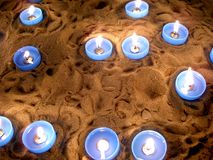 Church candles. Lighted candles in a cathedral sand pit Stock Image