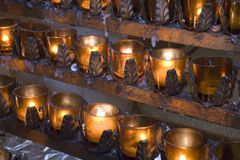 Church candles. Lit for prayers and offerings Stock Photo