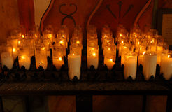 Church Candles. Group of lit Church candles in catholic mission Royalty Free Stock Photos