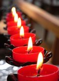 Church Candles. A row of red candles in a church Stock Images