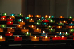 Church candles. Many colorful lit church candles Stock Images