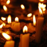 Church Candles. Lit at night time Stock Image