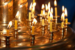 Church candles. Church wax candles on a candlestick Royalty Free Stock Photography