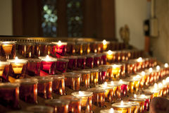 Church Candles. With angel by a door Royalty Free Stock Photos