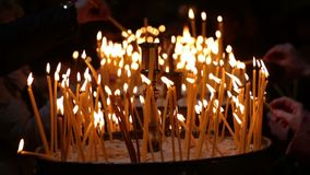 Church candles. With a background bokeh at Easter stock video footage