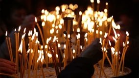 Church candles. With a background bokeh at Easter stock footage