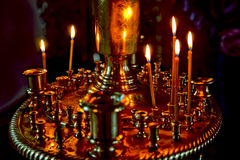 Church candles. Believers lit candles in the Church of the Holy Trinity St. Sergius Lavra Royalty Free Stock Photos