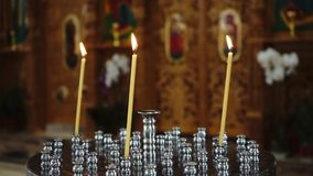 Church candles close up. Candles burning in the church stock video footage