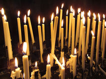 Church Candles in the Darkness Stock Photos