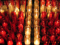 Church candles forming a cross. Lit church candles at Notre Dame Cathedral, Old Port, Montreal Stock Photo