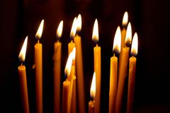 church candles glowing in the dark create a spiritual atmosphere stock photography