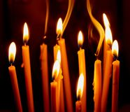 church candles glowing in the dark create a spiritual atmosphere stock photo