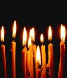 church candles glowing in the dark create a spiritual atmosphere stock photos
