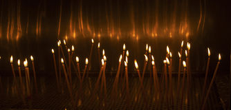Church candles glowing in the dark Stock Photo