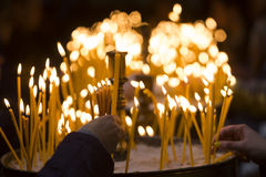 Church candles human hands Royalty Free Stock Photos