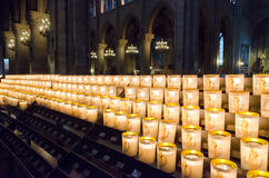 Church candles in Notre Dame Cathedral Royalty Free Stock Images