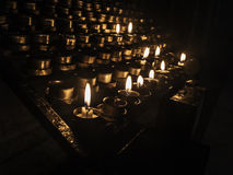 Church candles. Candles in a church for praying for wishes, free alms Royalty Free Stock Photography