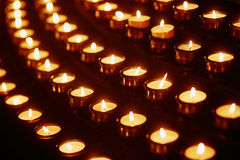 Church candles in yellow transparent chandeliers Royalty Free Stock Photography