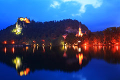 Church and castle in Bled lake in Slovenia evening Royalty Free Stock Photography