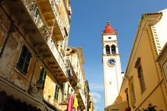 Agios Spyridon church cathedral tower Corfu Greece. Cathedral church tower silhouetted against a blue sky in Corfu Town, also known as Kerkira, the capital of Royalty Free Stock Image
