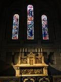 Church Catholic Altar. Church altar with beautiful stain glass windows Royalty Free Stock Photos