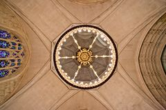 Church ceiling with lamp in center. Cross Stock Image