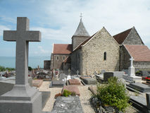 Church with cemetery. Historic church with a cemetery overlooking the sea in France Royalty Free Stock Photo