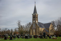 Church and Cemetery in Holland Stock Photo