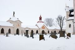Church and Cemetery in winter Stock Images