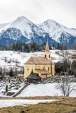 Church with cemetery in Zdiar village with Belianske Tatry mount Royalty Free Stock Photos