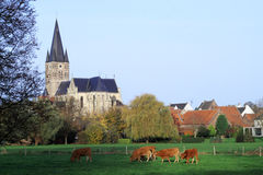 Church at the center of villages in Netherlands Stock Photos