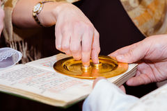 Church ceremony with rings and book Royalty Free Stock Images