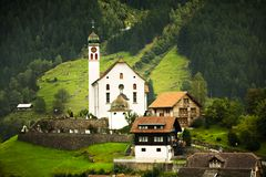 Church and Chalets, Switzerland Stock Images