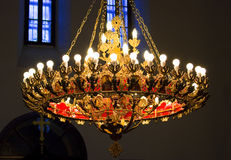 The church chandelier. Bronze chandelier in orthodox church with the cross and icon stock photography