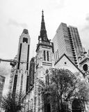 Church in Chicago. Black and white photo of a church in Chicago with several buildings in the background Royalty Free Stock Photo
