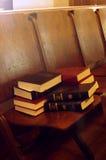 Church Choir. Song books on wooden seats in a church choir stock images