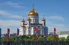Church of Christ the Savior during the world Cup in Russia, Moscow. Moscow, Russia - June 15, 2018: Welcome flags with symbols of the 2018 FIFA world Cup on the Royalty Free Stock Images