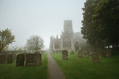 Church and church yard on a misty morning Royalty Free Stock Photos