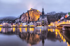Church and Citadel reflecting in river Meuse, Dinant Royalty Free Stock Images