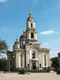 Church with a clock. Orthodoxy church with beautiful domes and clock Royalty Free Stock Image